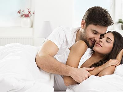 couple holding each other in bed